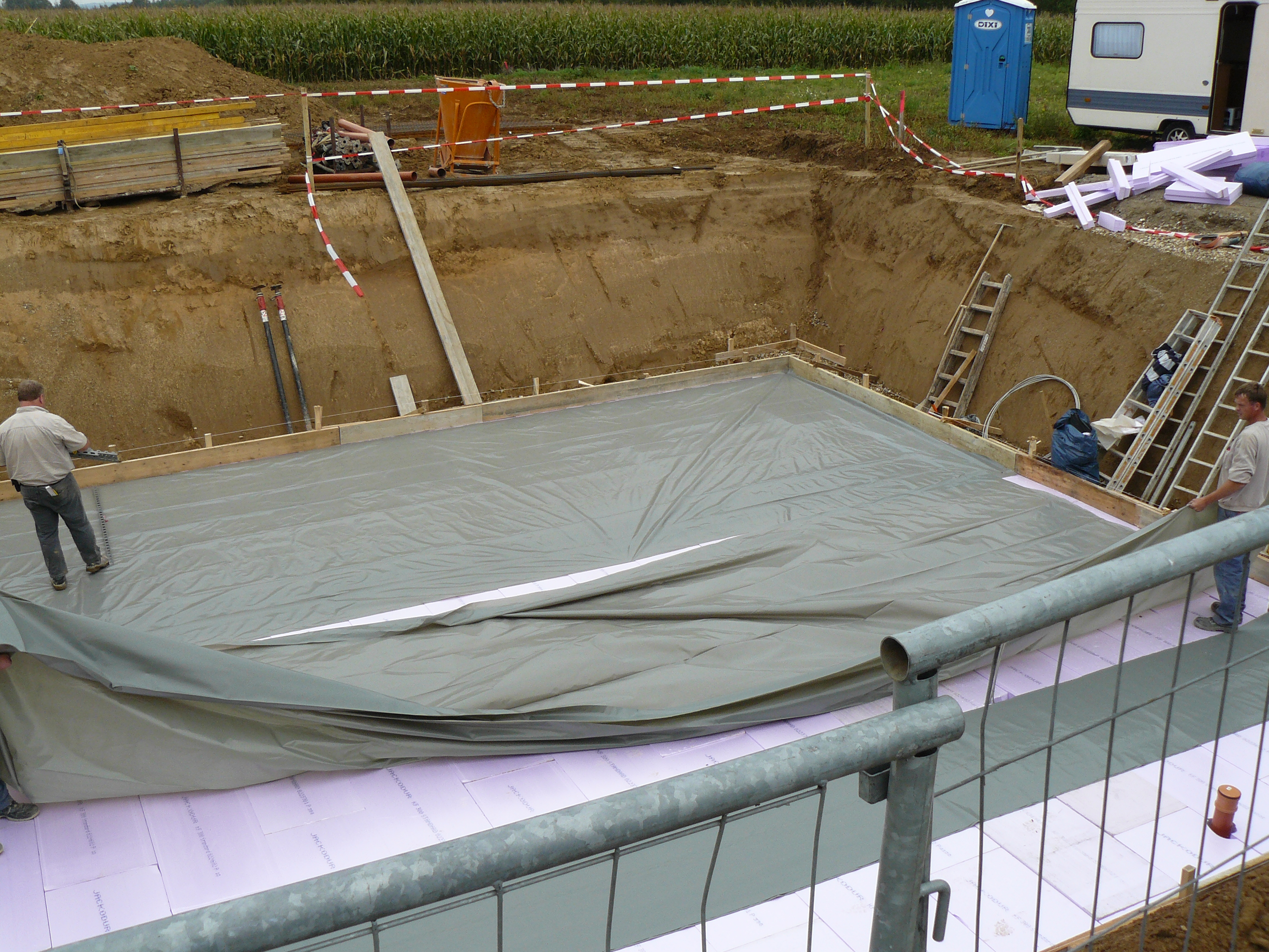 Folie zwischen Dämmung und Beton